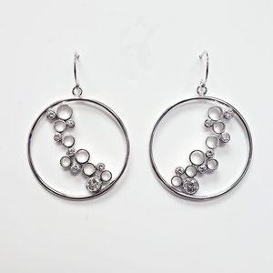 E 102 - 14K white gold earrings with bezel set diamonds.