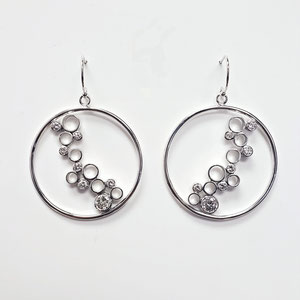 E 102 - 14K white gold earrings with bezel set diamonds.
