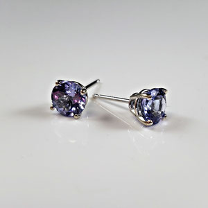 E 115 - 14K white gold basket style earrings with montana sapphire.