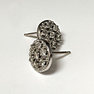 E 112 - 14K white gold disc earrings with 7 diamond melee.