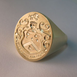 G 3 - 14K yellow gold hand engraved crest ring.