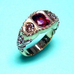 CS 9 - 14K rose and white gold ring with bezel set rubalite, champagne diamonds, and white diamonds.