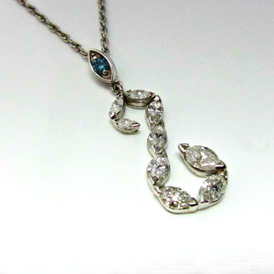 P 18 -  14K white gold pendant with marquise cut diamonds.