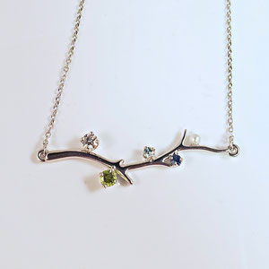 P 82 - 14K white gold  'family tree' necklace with diamond, pearl, blue zircon, peridot, and sapphire.