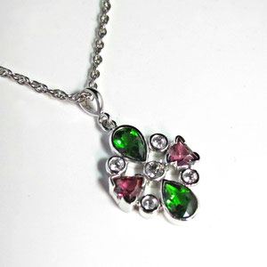 P 46 - 14k white gold pendant with bezel set chrome diopside, rhodolite garnet, and diamonds.