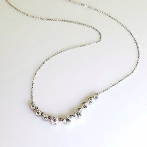P 120 - 14K white gold necklace with graduating diamonds.