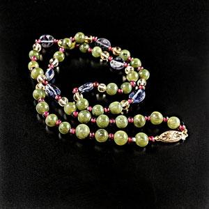 P 111 - Iolite, Citrine, Jade, and Garnet beads.
