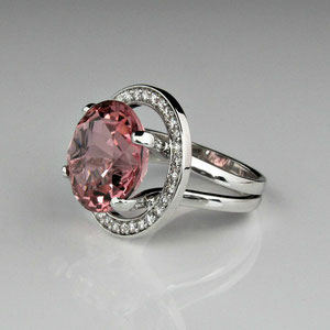 CS 1 - 14K white gold ring with center rose quartz and a halo of bead set diamonds.