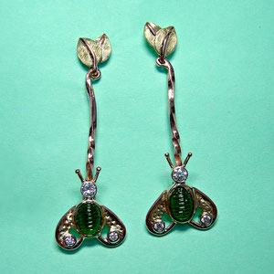 E 13 - 14K fabricated rose and green gold earrings with diamonds and carved green tourmalines.
