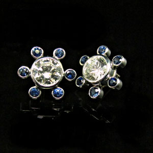 E 86 - 14K white gold earrings with sapphires and diamonds.