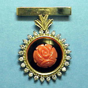 PB 13 - 14k yellow gold pin featuring an onyx and carved coral dangle surrounded by diamonds.