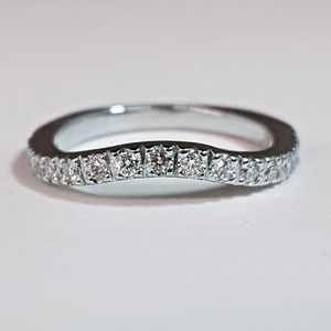 B 14 - 14k white gols conture band with bead set diamonds.