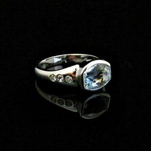 CS 41 - 14K white gold ring with bezel set aquamarine and gypsy set diamonds.