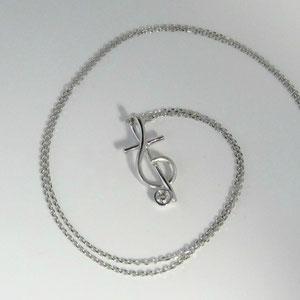 P 12 -  14K white gold pendant with bezel set diamond.