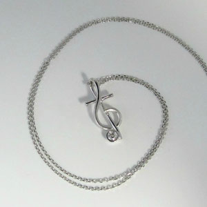 P 12 -  14K white gold pendant with bezel set diamond.