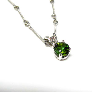 P57 - 14K white gold scroll style pendant with tourmaline.
