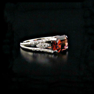CS 46 - 14K white gold ring with emerald cut pink tourmaline and melee diamonds.