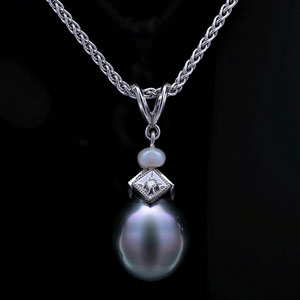 P 4 - 14K white gold pendant with south sea pearl, diamond, and white pearl.