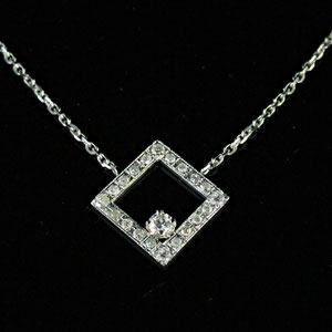 P 48 - 14k white gold necklace with bead set melee diamonds in the square and a prong set diamond.