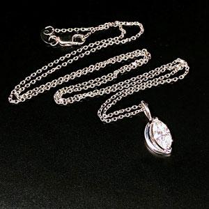 P 123 - 14K white gold 'moon' pendant with marquise diamond.