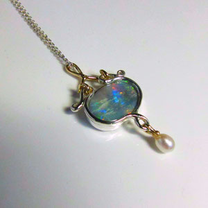 P 55 - Sterling and 14K yellow gold opal pendant with pearl.