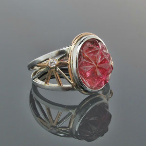CS 11 - 14K Two toned gold ring with carved tourmaline and diamond accents.