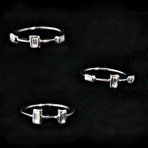 B 10 - 14k white stacking rings with bezel set baguette diamonds.