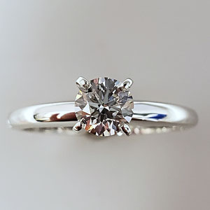 WF 87 - 14K white gold 4 prong diamond solitaire.