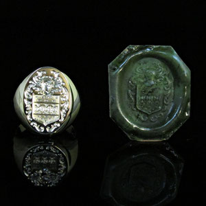 G 11 - 14K yellow gold hand engraved crest ring with wax relief.