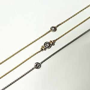BR 11 - A variety of diamond bracelets in 14K gold.