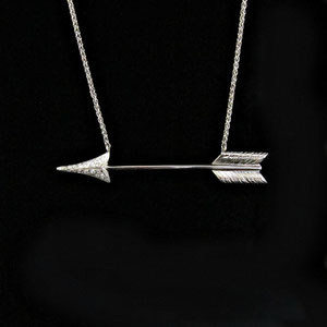 P 72 - 14K white gold arrow necklace with pave' set diamonds.