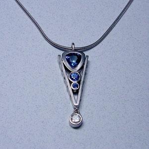 P 17 - 14K white gold pendant with bezel set diamond and bezel set sapphires.