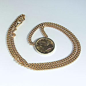 P 52 - 14K yellow gold chain and coin necklace.