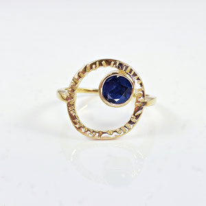 CS 63 - 14K yellow gold ring with bezel set sapphire inside hammered circle.