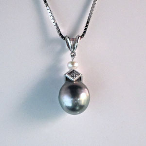 JS 9.2 -  14K white gold pendant with south sea pearl, diamonds, and white pearl.