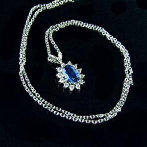 P 47 - 14k white gold Princess Di style sapphire and diamond pendant.
