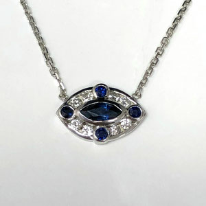 P 102 - 14K white gold pendant with center marquise sapphire - surrounded by sapphires and diamonds.