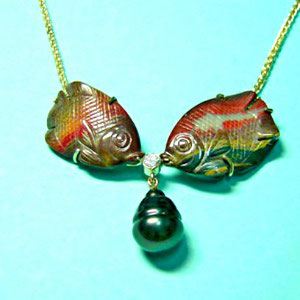 P 23 - 14K yellow gold necklace with carved agate fish, diamond, and south sea pearl.