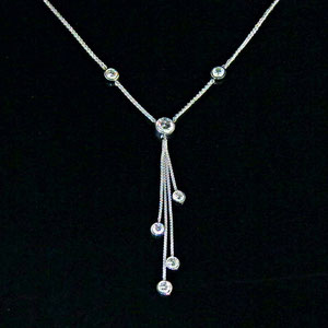 P 50 - 14k white gold necklace with bezel set diamonds. The dangle is removable, see P 51.