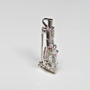 P 76 - 14K white pin/pendant combination. Side view.