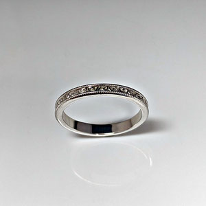 B 35 - 14K white gold wedding band with sculptural design.