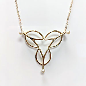 P 103 - 14K yellow gold 'Trillium' necklace, with 3 pearls.