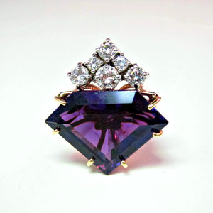 P 66 - 14K two toned gold pendant with shield shaped amethyst and diamonds.
