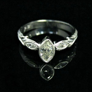 DF 30 - Paladium ring with bezel set marquiese diamond. Hand carved embeleshments.