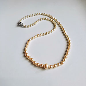 P 86  - Graduated 'ombre' pearls with white gold catch.