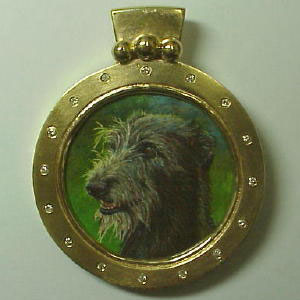 P 37 - 14K yellow gold pendant with photo etched portrait, and diamonds.