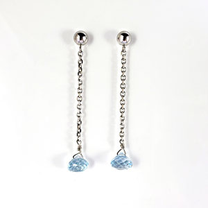 E 114 - 14K white gold dangle earrings with blue topaz briole.