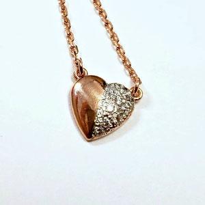 P 93 - 14K rose gold heart shaped pendant with bead set diamonds.