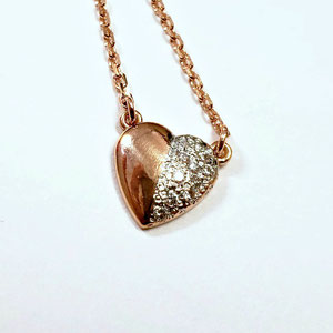 P 93 - 14K rose gold heart shaped pendant with bead set diamonds.