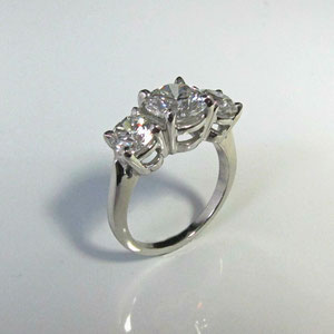 WF 6 - 14K white gold three stone diamond ring.